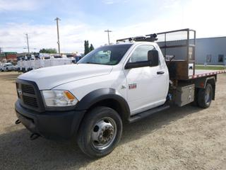 2012 Dodge Ram 5500 4X4 Regular Cab Flat Deck c/w 6.7L Cummins Diesel, A/T, 236,015 KMS, 7,092 Hours, 12' Deck, Kargo King 2 8,000 Roll-Off System, VIN 3C7WDNBL3CG219105 *NOTE: Out Of Province - Manitoba*