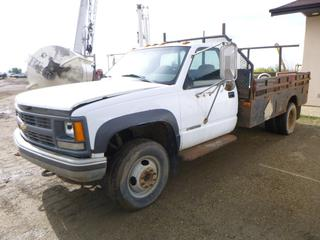 "2000 Chevrolet 3500 4X4 Flat Deck Truck c/w Vortec Engine, Showing 297,979 KMS, A/C, 11' x 7'5"" Deck, 225/75R16 Tires At 50%, Rear Dually, VIN 1GBJK34J9YF506880 *NOTE: Running when parked, No Start, No Battery, With Contents*"