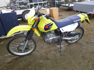 2007 Suzuki DR 200 Dual Sport Motor Cycle c/w 199 CC 4 Stroke, Showing 4,142 KMS, 5 Speed, Electric Start, Front Tire 70/100-21M/C, Rear Tire 100/90-18M/C, VIN JS15H42A572100313 *NOTE: No Battery, Front Tire Flat, Running Condition Unknown* (SC)