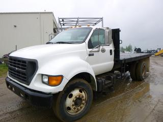 "2000 Ford F-650 Super Duty Flat Deck c/w Cummins ISB, 190 HP, A/T, A/C, Showing 305,999 KMS, GVWR 11,793KG, 260"" W/B, 14' x 8' Deck, 10R22.5 Tires, Front Axle Rating 3,855KG, Rear Axle Rating 7,937KG, VIN 3FDNF6583YMA24299"