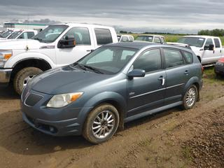 2006 Pontiac Vibe 4 Door Hatch Back c/w 1.8L VVT 16 Valve, A/T, A/C, AWD, Showing 299,999 KMS, Fold Down Rear Seat, Roof Rack, 205/60R16 Tires At 20%, VIN 5Y2SL65816Z406004 *NOTE: Check Engine Light On*