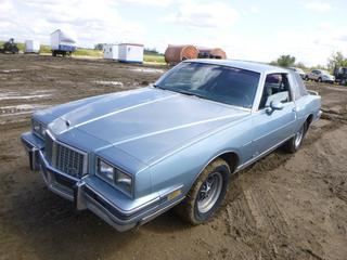 1986 Pontiac Grand Prix c/w V8, A/T, A/C, Showing 26049.8 Miles, Power Windows/Locks, Front Tires P235/60R14 At 50%, Rear Tires 215/75R14 At 50%, VIN 2G2GK37H9G2270282 *NOTE: Out Of Province, SK*