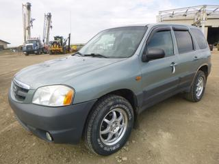 2003 Mazda Tribute c/w 3.0L V6 DOHC 24 Valve, A/T, A/C, Showing 195,280 KMS, Heated Side Mirror, Navigation System, 235/70R16 Tires At 40%, VIN 4F2YZ02143KM02689 *NOTE:  Runs Rough, Navigation System Non Functional, Rust Around Rear Wheel Well*
