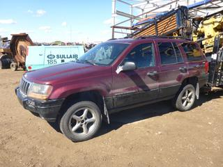 "1999 Jeep Grand Cherokee Laredo 4X4 c/w 4.0L Power Tech, Showing 323,952 KMS, A/C, In Dash 7"" Wide Screen LCD Monitor, 235/55R17 Tires At 5%, VIN 1J4GW58SXXC760665 *NOTE: Vehicle Turns Over But Does Not Start*"