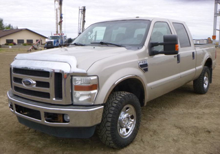 2009 Ford F250 Super Duty XLT 4X4 Crew Cab c/w 5.4L, A/T, A/C, Fully Loaded, 7' Box, LT 265/70R17 Tires At 80%. Showing 334,022 KMS. VIN 1FTSW21549EA02508 *NOTE: Back Bumper Cracked, Rear Passenger Power Window Goes Down But Not Up From Drivers Seat, Box Lined With Plywood, Some Paint Chips and Rust*