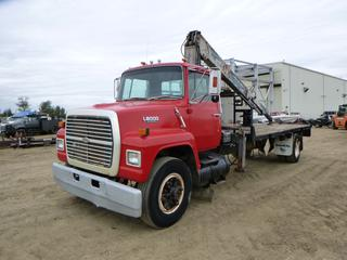 "1989 Ford L8000 Flat Bed Picker c/w 306 Diesel, 5 Speed, Hydraulic Brakes, Showing 459,389.1, GVWR 30,000 LB, 264"" W/B, 11R22.5 Tires At 90%, Front Axle Rating 4,082 LB, Rear Axle Rating 9,525 KG c/w Atlas AK400611 Picker, Deck Width 94 In., Deck Length 20 Ft., VIN 1FDPR82A2KVA06554"