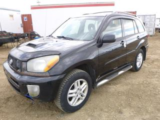 2003 Toyota Rav4 4WD c/w 2.0L, 5 Speed Manual, Showing 330,492 KMS, 215/70r16 Tires At 80%, Winter Force Tires, VIN JTEHH20VX36078091 *NOTE: Broken Console, Windshield Needs To Be Replaced, Damaged Front and Rear Bumper, Cut Key only, needs Special Starting Procedure*