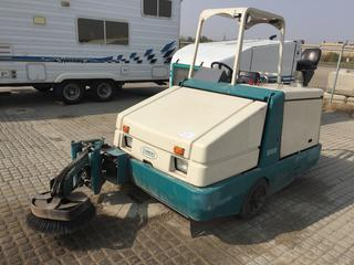 Tennant 385 Sweeper c/w Ford 4 Cyl Gas, Hydrostatic Trans, ROPS. Showing 956 Hours. S/N 385-5974.