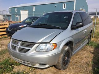 Selling Off-Site - 527 North 200 East, Raymond, AB -  2005 Dodge Grand Caravan c/w Auto Trans, VMI Wheel Chair Ramp, Showing 112,836 Kms. S/N 1D1GP24R658136551