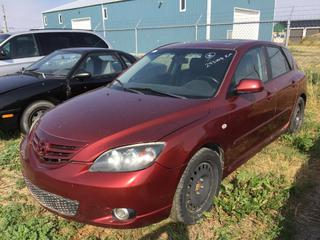 Selling Off-Site - 527 North 200 East, Raymond, AB -  2006 Mazda 3 4 Door Car c/w Auto Trans, Showing 243,008 Kms. S/N JM1BK143361532889