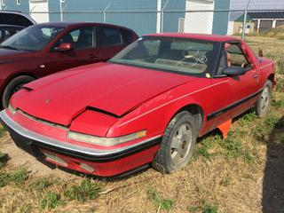 Selling Off-Site - 527 North 200 East, Raymond, AB -  1989 Buick Reatta 2 Door Car c/w Auto Trans, S/N 1G4EC11C0JB904699. Note:  Kms Unknown, No Keys.
