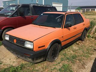 Selling Off-Site - 527 North 200 East, Raymond, AB -  1992 VW Jetta 4 Door Car c/w Diesel, 5 Spd Trans, Showing 255,828 Kms. S/N WVWPG01G1NW028710