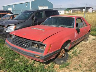 Selling Off-Site - 527 North 200 East, Raymond, AB -  1983 Ford Mustang 2 Door c/w Manual Trans, S/N 1FABP16T1CF234652. Note:  Parts Only.