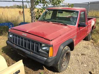 Selling Off-Site - 527 North 200 East, Raymond, AB -  Jeep Comanche Truck c/w Manual Trans, Showing 342,144 Kms. S/N 1J7FT26L9KL434608