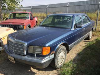 Selling Off-Site - 527 North 200 East, Raymond, AB -  1986 Mercedes 300 SDL 4 Door Sedan c/w Diesel, Auto Trans, Showing 512,049 Kms. S/N WDBC25036A267361