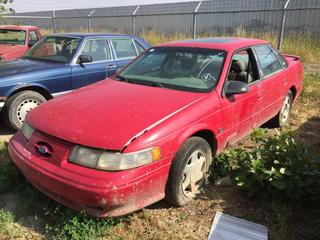 Selling Off-Site - 527 North 200 East, Raymond, AB -  1994 Ford Taurus SHO 4 Door c/w Manual Trans, Showing 260,614 Kms, No Keys, Parts Only S/N 1FALP54Y2RA116917