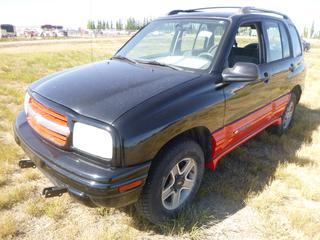 *SELLING OFFSITE COALDALE, AB* 2002 Chevrolet Tracker 4x4 c/w 2.0L 4 Cyl, Auto, AC, Tilt, Cruise, Pwr Windows, Locks, & Mirrors, w/ Tow Bar. Showing 429,023 Kms. S/N 2CNBJ13C126950892.
