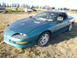 *SELLING OFFSITE COALDALE, AB* 1994 Chevrolet Camaro c/w 3.4L V6, 5 Spd Manual, AC, Tilt, Cruise, Pwr Windows, Locks, & Hatch. Showing 208,370 Kms. S/N 2G1FP22S8R2216425.