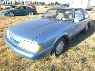 *SELLING OFFSITE COALDALE, AB* 1992 Ford Mustang LX c/w 2.3L 4 Cyl, Auto, AC, Tilt, Cruise, Pwr Windows, Locks, Hatch & Mirrors. Showing 84,117 Kms. S/N 1FACP41M0NF111434.