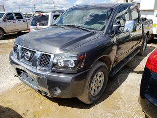 2005 Nissan Titan 4X4 Pick Up C/w 5.6L V8, A/T, A/C, 285/70R17 Tires. Showing 53,000KMS. VIN 1N6AA07B55N503152 *NOTE: Running Condition Unknown, No Key, Pinion Gear Issue, No Reverse, Possible Fire Damage, Front Driver Door Damage, Tow Mode*