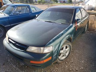 1999 Nissan Maxima. VIN JN1CAZ100XT825586 *NOTE: Running Condition Unknown, No Key*