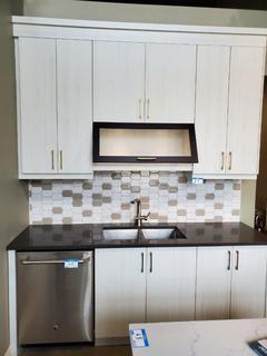Galley Style Brown / Off White Kitchen Cabinets, w/Gold Handle Accents (appliances not included). (See pics for sizing and details)