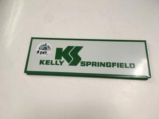 "Kelly Springfield Sign, 11"" x 3 3/4""."