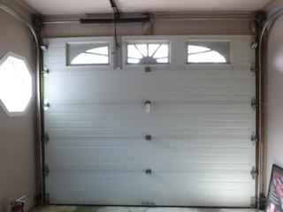 10ft X 8ft 5-Panel 3-Light Garage Door C/w Track And 1/2HP Chamberlain Lift Master Garage Opener **Note: Cannot Be Removed Before Nov. 10th, Buyer Responsible For Load Out, Located Offsite For More Info Contact Shazeeda @780-721-4178**