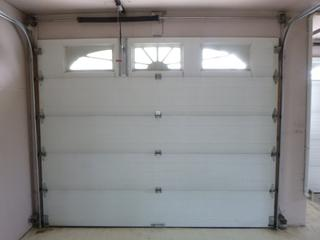 10ft X 8ft 5-Panel 3-Light Garage Door C/w 1/2HP Steel-Craft Garage Opener And Track **Note: Cannot Be Removed Before Nov. 10th, Buyer Responsible For Load Out, Located Offsite For More Info Contact Shazeeda @780-721-4178**