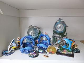 Qty Of Dolphin Ornaments **Note: Buyer Responsible For Load Out, Located Offsite For More Info Contact Shazeeda @780-721-4178**