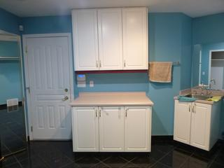 Utility Room Cabinet w/ 49.5in X 25in X 35.5in  Counter Top And 3-Door Upper Cabinet **Note: Buyer Responsible For Load Out, Located Offsite For More Info Contact Shazeeda @780-721-4178**