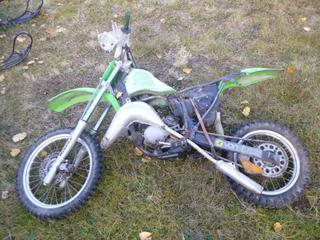 1990 Kawasaki KX85 Dirt Bike c/w 70/100-16 Front Tire At 50%, 90/100-14 Rear Tire At 50%, VIN JKAKXWL14LA009109 *NOTE: Parts Only*