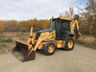 2005 Deere 310SG 4x4 Loader Backhoe  c/w A/C, Aux. Rear Hydraulics, Front Weights, 12.5/80-18 Front, 19.5L-24 Rear Tires. Showing 3,381 Hours. S/N T0310SG948353.