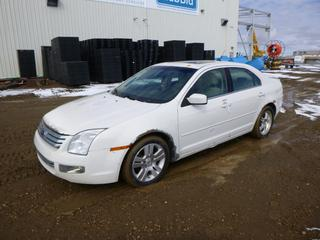 2009 Ford Fusion SEL c/w 3.0L V6, A/T, A/C, Showing 136,931 Kms, P225/50R17 Tires at 0%, VIN 3FAHP08169R209872 *Note: Rust, Battery Light On, Needs New Power Steering Pump*