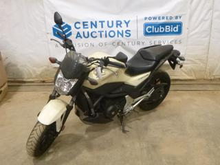 2013 Honda NC700S Motorcycle c/w 700, Manual, Showing 1 Kms, 120/70ZR17 Tires at 100%, VIN JH2RC612XDK100089 *Note: ABS Light On, Smoke Damage*