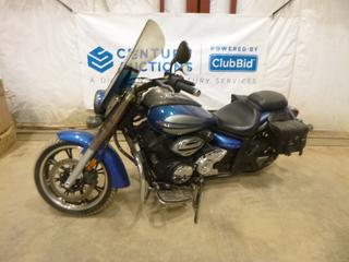 2009 Yamaha V-Star c/w 950, Manual, Showing 5,559 Kms, 130/70-18MC Front Tire at 80%, 170/70B16MC Rear Tire at 80%, VIN JYAVN01NX940000642 *Note: Smoke Damage, Wind Screen Bent c/w Leather Saddle Bags*