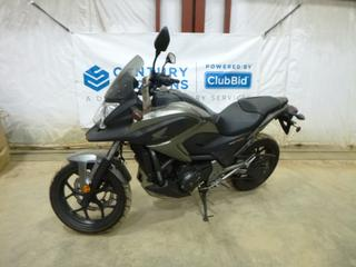 2014 Honda NC750X Motorcycle c/w 750, Manual, Showing 20 Kms, 120/70ZR17 Tire at 100%, 160/60ZR17 Rear Tire at 100%, VIN JH2RC7228EK000238 *Note: ABS Light On, Smoke Damage*