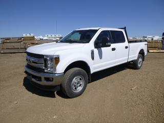2019 Ford F-350 XLT Super Duty 4X4 Crew Cab Pick Up c/w 6.2L, A/T, A/C, Showing 37,291 Kms, Headache Rack, Manual Hub, 8 Ft. Box, LT275/70R18 Tires at 70%, Rears at 80%, VIN 1FT8W3B67KEF44196 *Note: Damage to Box and Tailgate*