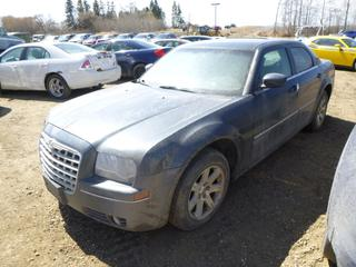 2007 Chrysler 300 c/w 3.5L V6, A/T, Showing 206,455 Kms, 215/65R17 Tires at 10%, VIN 2C3KA53G37H823253 *Note: Runs, Does Not Drive*