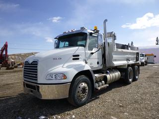 2016 Mack CXU613 Gravel Truck, M-drive 12 Speed Auto Transmission, 415 HP MP8 Diesel, T/A, 13,200 Lb Front, 44,000 Lb Rear, GVWR  57,200 Lb c/w AC, A/R, Beacons, Electr Tarp, Plumbed For Pup. Needs New Rear Tires. Showing 72,555 Kms. VIN 1M2AW21C6GM053954.