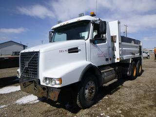 2006 Volvo Gravel Truck 435 HP VED12 Diesel, T/A, Eaton Fuller 18 Spd, 14,600 Lb Front, 40,000 Lb Rear, GVWR 54,600 Lb, c/w A/C, Manual Tarp, Spring Susp, Plumbed For Pup. Showing 433,821 Kms. VIN 4V5KC9GH16N401195 .*Passenger Door Doesn't Open**Damage to Front Bumper*