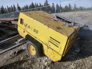 Atlas Copco XAS85 Portable Air Compressor, 195/75R14, Showing 1985 Hours, **Missing Hitch, Running Condition Unknown**