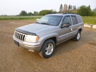 2000 Jeep Grand Cherokee 4X4 c/w 4.0L Powertech, A/T, Showing 413,753 Kms, Power Sunroof, 235/70R16 Tires at 10%, VIN 1J4GW58SXYC352197 *Note: Missing Hood Hydraulics, Damage and Rust*