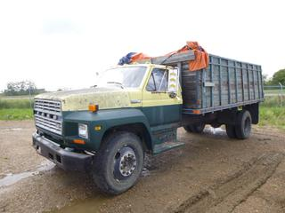1982 Ford F-700 c/w 6.1L, Showing 278,776 Kms, PTO, 16Ft Wooden Grain Box, Hoist, GVWR 23,100 Lb, 207 In. W/B, 10R22.5 Tires at 10%, VIN 1FDNF70H7CVA33373 *Note: Turns Over, Does Not Start*