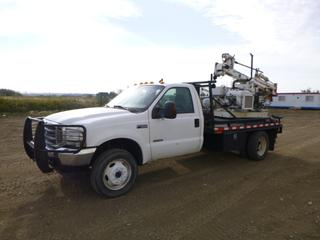2003 Ford F-450 Super Duty XLT 4x4 Flat Deck Truck c/w 6.0L Power Stroke V8, Diesel, 5 Speed Manual, A/C, Showing 332,213 Kms, PTO, Manual Hub, 10 Ft. Deck, Storage Cabinet w/ Drill Bits and Drill Rod Extensions, Out Rigger Pads, GVWR 15,000 Lb, 255/70R19.5 Front Tires at 60%, Rear Dually at 70% w/ Simco 2400 Drill Team Piling Rig w/ Air Compressor and Breaker, Air and Hydraulic, 1 1/2 In. Bore, Showing 2,699 Hours, Wisconsin Engine, Model VG4D, VIN 1FDXF47P43EC97591