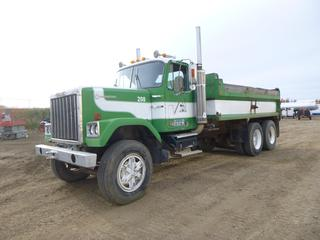1985 GMC General 15 Ft. T/A Dump Truck c/w Caterpillar Engine, Showing 144,380 Kms, Fuller Road Range 13 Speed, A/C, PTO, GVWR 39,600 KG, 11R24.5 Tires, Manual End Gate, VIN TFV518939 *Note: Headliner Damage*