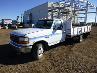 1994 Ford F-350 XL Flat Deck Truck c/w 7.5L V8, 5 Speed Manual, Showing 245,449 Kms, A/C, 12 Ft. Deck, LT22575R16 Tires at 10%, Dually Rears at 80%, VIN 2FDJF37G2RCA67305