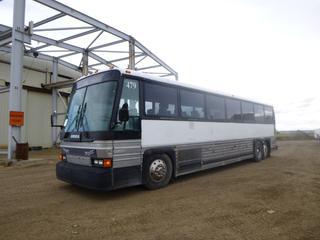 1986 Motor Coach Industries 102-A3 Passenger Bus c/w Diesel, Manual Transmission, Showing 831,885 Kms, A/C, 47 Passenger Capacity, Bathroom, Tv's, GVWR 37,800 Lb, Front Axle Rating 14,000 Lb, Rear Axle Rating 28,000 Lb, VIN 1M8FDM7A3GP040791
