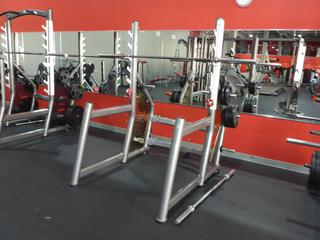 Approx. 76in X 50in Matrix Squat Rack C/w Weights And Bar