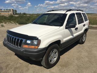 2001 Jeep Grand Cherokee Laredo 4x4 SUV c/w 4.0L, Auto, A/C, Cruise, Auto Windows, Auto Door Locks, Showing 252,002 Kms VIN 1J4GW48S51C702139
